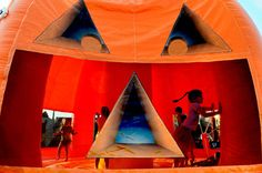 Journal Star Photos of the Month - Children bounce inside a pumpkin-shaped inflatable at the Morton Pumpkin Festival.