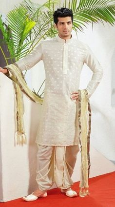 Dhoti kurta makes a nice statement wear for men, women and kids. Here the 15 best dhoti kurta designs in a different style for wedding and other occasions. Couple Wedding Dress, Wedding Outfits For Groom, Groom Wedding Dress, Wedding Attire, Wedding Wear, Sherwani For Men Wedding, Wedding Dresses Men Indian, Sherwani Groom, Mens Sherwani