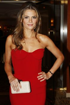 Stana Katic in a strapless red dress at the Consulate of General of Canada Luncheon