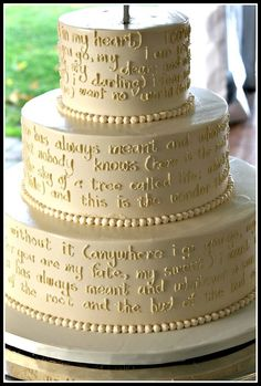 wedding cake with a hand piped poem by ee cummings 'i carry your heart'. done by 'Bella e Dolce', northern Michigan area bakery