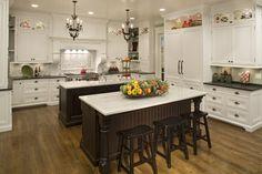 White kitchen, two dark islands by Siena Custom Builders