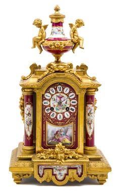 A Louis XVI Sevres Style Porcelain Mounted Gilt Bronze Table Clock