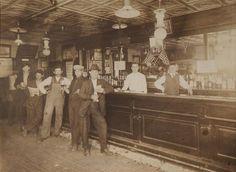 AMERICAN SCHOOL (C. 1900): INTERIOR OF A BAR...