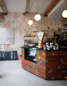 The Village Coffee & Music | Utrecht. Distressed walls & cute timber bench with pops of colour.