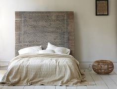 Headboard - it looks like a panel from a home of the Toraja people