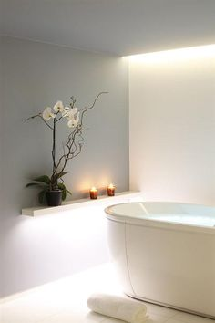 clean lines and blissful white spa bathroom ... I like the grey wall