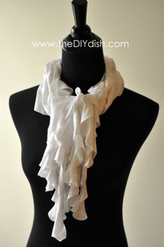 "Make this ruffle scarf using an old T-shirt. Take a 9"" paper plate as your template and cut out 6 circles of T-shirt fabric. Then cut these circles of fabric in a spiral pattern (about 2"" wide). Stretch this length of fabric and glue (or stitch) to another length of fabric. Do the same until you get the thickness you desire. Done! @ winkchic.orgwinkchic.org"