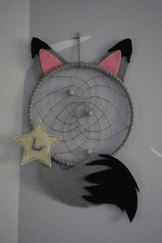 Cute fox or wolf dream catcher that fits in perfectly to any woodland themed bedroom or nursery and is gender neutral. The webbing and beads will help to trap the bad dreams while the hole in the middle allows the good dreams to reach the dreamer below. Please comment at the