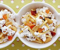 Snack Mix - Toss together a healthy combo of nuts, pretzels, whole grain cereal, banana chips, and popcorn for a handy, portable snack. Nuts contain must-have minerals such as magnesium, iron, and zinc. #kidfriendly #Popcorn
