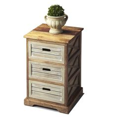 Handcrafted with washed and natural wood tones, this Modern Expressions Chairside Chest offers three drawers for convenient storage. Charmingly designed, this side table features open 'X' side supports for a modern aesthetic.