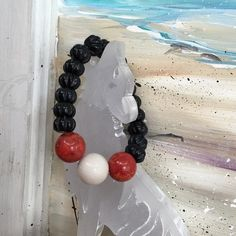 White Onyx Red Coral & Tiger's Eye Bracelet Big & Bold Genuine White Onyx, Red Coral, & Black Tiger's Eye Beaded Stretch Bracelet. Will Ship in Gift Pouch. Comes from a nonsmoking with fluffy furkids home. Mutt Couture Design Jewelry Bracelets
