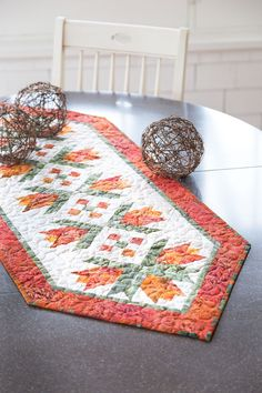 If you've been itching to make something out of batiks, here's a fast and easy table runner to satisfy your craving. There's no complicated piecing either– just simple seaming. Kay Berquist also made this table runner in a violet colorway. Digital pattern available! Look for Orange City Tulips in Easy Quilts Fall '14.