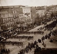President Lincoln's funeral procession on Pennsylvania Avenue. Coffin visible in the street. It was made in 1865.  Lincoln's funeral on Pennsylvania