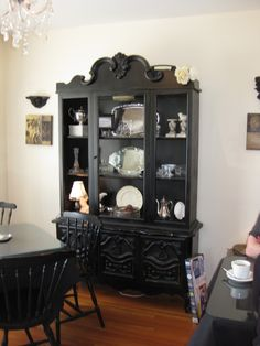 China cabinet: Similar to the one I got from a neighbour, but I removed the molded doors and crazy topmolding. Still need to paint mine though!