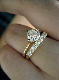 Wow. This is pretty cool. Maybe not the wedding band, but the engagement ring is unique, yet simple, but so pretty. I love solitaires (:(: