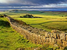 Hadrian's Wall built by the Romans to keep the Scottish tribes from invading Britannia. The wall was 80 miles long and 16-20 ft high.