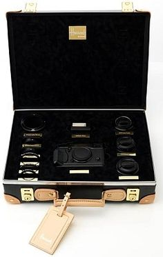 Fujifilm and British luggage manufacturer, Globe Trotter's limited edition, Vulcanised Fibreboard suitcase for the Fujifilm X-Pro1 to be sold at Harrods.