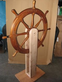 "There are a couple of different ways to build a motorized ship's wheel.I built a mount with 2""x5"" wood, and then added a wiper motor below and to the side of the wheel. The motor is connected to a 4"" piece of slightly bent aluminum that is loosely connected to a 15"" PVC pipe. As the aluminum piece rotates, the PVC pipe moves up and down, making the wheel spin to the left and then to the right.You may want to use a wiper motor with a 5V power supply so"