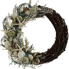 Don't forget the beach house when decorating for the holidays. This natural grass and shell wreath is the perfect door décor. | $111 Artificial Plants, Home Accents, Grapevine Wreath, Accent Decor, Planting Flowers, Home Depot, Floral Wreath, Fake Plants, Floral Crown