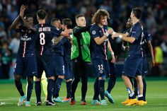 David Luiz and Javier Pastore of PSG shake hands as they celebrate victory in the Group F UEFA Champions League match between Paris Saint-Germain v FC Barcelona held at Parc des Princes on September 30, 2014 in Paris, France.