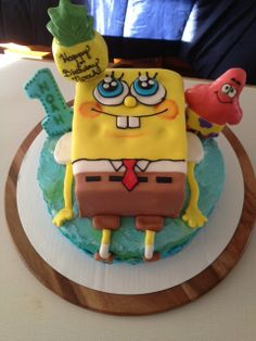 Spongebob Squarepants - The bottom round cake is chocolate with a cannoli filling.  It is air brushed on a buttercream frosting. Spongebob is a yellow cake with a lemon curd filling.  Spongebob is covered in MMF.  The #1, Patrick & the pineapple are all made from rice krispie treats and covered in fondant.