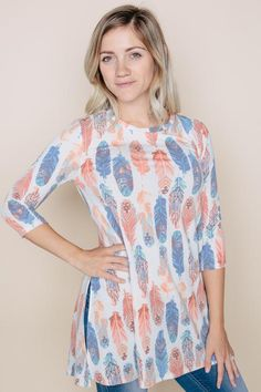 Calling all FEATHERS FANS!  The new Amelia James Feathers Tacoma is available now in sizes XS-3X!