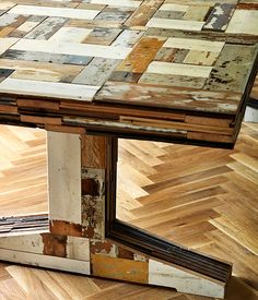 Table made from recycled floor boards