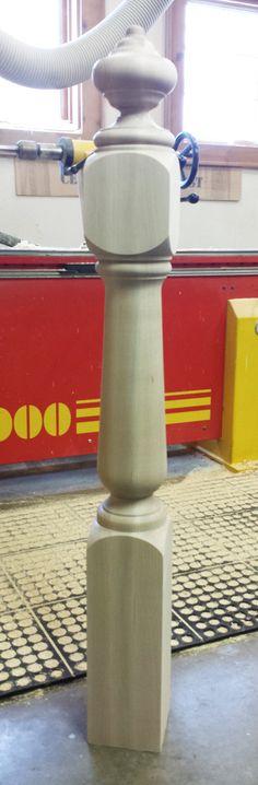 A custom turned newel post made in poplar.