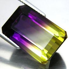 Bi-Color Ametrine, Purple to Lemon Yellow - Ametrine energies are said to stimulate the intellect and rid the aura of negative energy. It is also said to be helpful for releasing negative emotional programming. Ametrine is repurted to mystically aid in meditation, boost psychic abilities, relieve tension, disperse negativity and help to eliminate prejudice. It also has the basic metaphysical and healing properties of both the amethyst and the citrine that comprise it.