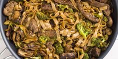 Skinny Beef & Broccoli Noodles - With soy sauce-infused flank steak and broccoli, these rice noodles are so much better than takeout.​