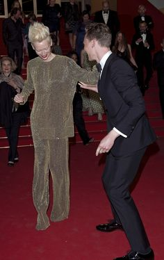 Tom Hiddleston and Tilda Swinton dancing on the red carpet at the Premiere of 'Only Lovers Left Alive' during the 66th Annual Cannes Film Festival at the Palais des Festivals on May 25, 2013 in Cannes, France