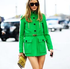Olivia Palermo in a green coat dress and snake print clutch