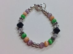 Baby girl bracelet, Purple, Orange and Green, Swarovski Crystals on Etsy, $8.00