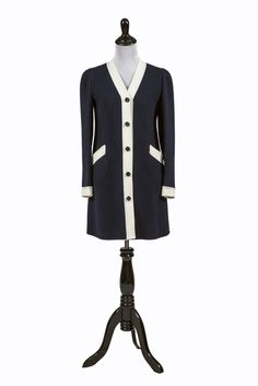 Rare Vintage Valentino 1960s Dress This is one of our favorite Valentino pieces! This rare Valentino 1960's structured navy blue wool dress has white wool trim and buttons up the front. This fabulous
