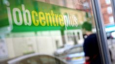 Pay increases fall behind inflation as UK unemployment drops by 53,000 in the three months to March.