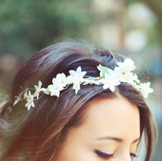 flower crown... With heavier flowers tucked into braid in back