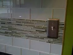 Cream Subway Tile Backsplash Wide Varigated Trim Row Two Rows Above Counter Top