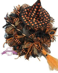 Orange and Black Halloween Witch Wreath This orange and black witch wreath will add glamour and glitz to your front door or halloween home decor this season. It is full of festive halloween color ribbon, a witches hat and a matching witches broom. This wreath was made on a wreath frame with orange and black check deco mesh and accented with more black deco mesh. It is full of several different patterned ribbon streamers. This wreath measures approximately 31long x 31 wide and 12 deep, tip…