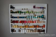 DIY thread storage. She also gives a great tip for measuring with elastic and making bobbin keepers.