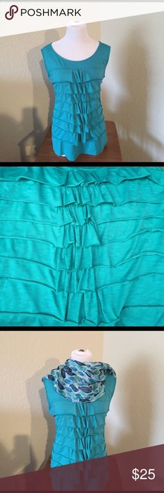 Rafaella teal XL sleeveless top. Rafaella XL teal sleeveless top. Ruffled front.  In good used condition.  The second picture shows the true color. Rafaella Tops Tank Tops