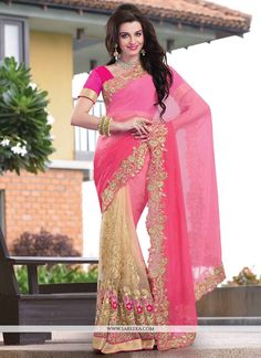 Pink and beige georgette half and half saree is design with glitzy fancy thread resham embroidered foliage and floral patterns on the lower part and sprinkled stick on crystals embellished second half...