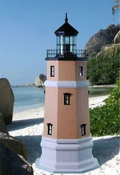 Deluxe Custom Crafted Split Rock Lighthouse ~ ...This attractive Deluxe Custom Crafted model of the Split Rock Lighthouse was created by The Lighthouse Man. They strive to stay as close to the original lighthouse as possible with their designs and pride of workmanship is evident. What a wonderful focal point for your nautical garden! The lighthouse was meticulously handcrafted from synthetic stucco and masonry over a solid foam core, making it virtually impervious to the elements...