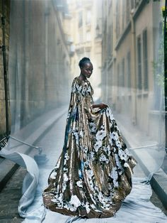 """Night at the Opera - """"Before, I was just going on instinct, but Yale taught me that it's about giving yourself permission to pretend,"""" says Lupita. Dolce & Gabbana Alta Moda sequined cape."""
