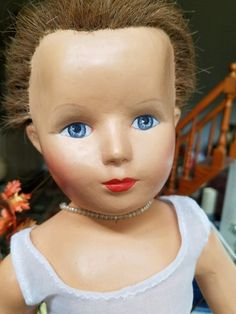 """Rare composition Monica of Hollywood doll with rooted hair. She is a 20"""" doll with rooted human hair - the only composition doll made with rooted hair. Her hair has some breakage and has been put into a bun. 