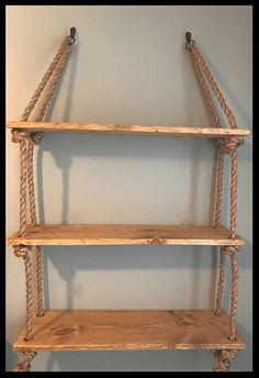 Beautiful large hanging rope and wood planks shelves. Boards are hand-made - Beautiful large hanging rope and wood planks shelves. Boards are stressed by hand … - Dorm Shelves, Diy Hanging Shelves, Hanging Rope, Wood Plank Shelves, Wood Planks, Rustic Bathroom Organizers, Rustic Bathrooms, Wall Organization, Traditional Decor
