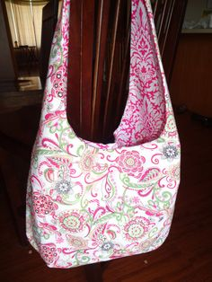 Paisley style pink and lime green fabric, Over the Shoulder Purse, two inside pockets, great bag to carry everything you need for on the go