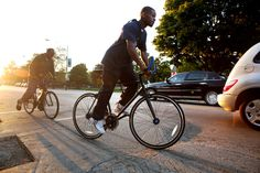 """'Slow Roll' cyclists aim to revive neighborhoods  As Oboi Reed and Jamal Julien weaved their bikes around parked cars and potholes Thursday in Chatham, a woman on the sidewalk called out, """"Y'all are riding in the street?""""  http://www.chicagotribune.com/news/ct-slow-roll-chicago-met-20140919-story.html"""