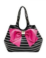 KNOT YOUR AVERAGE TOBO -     What makes a bag great? A big pink bow! This roomy…