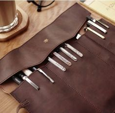 Vintage strap folding roll pen curtain leather pencil case large capacity stationery storage bag cosmetic bag $4.39