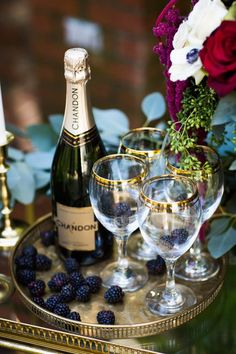 Champagne & berries in gold rimmed glasses | Photo by Dina Chmut via http://junebugweddings.com/wedding-blog/berry-wine-wedding-inspiration/
